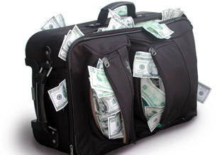 Travel luggage full of foreign currency