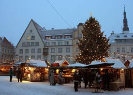 People shopping from market stalls at the Tallin Christmas market