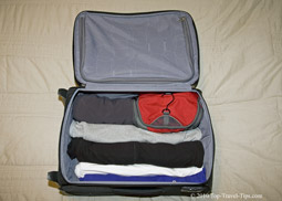 Luggage packing - Rolled up items of clothing in a carryon luggage