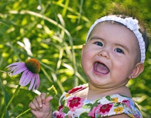 Smiling toddler with flower