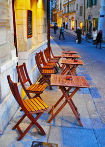 Outdoor cafe tables in a narrow street