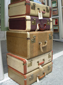 Stack of five old luggage bags