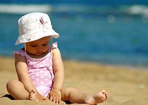 Toddler sitting on beach