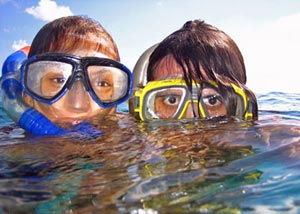 Two kids snorkelling